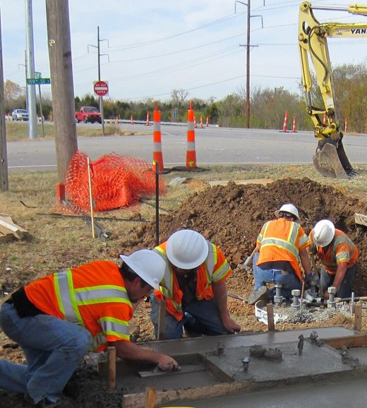 Crew installing turn signals at 159th/US-54